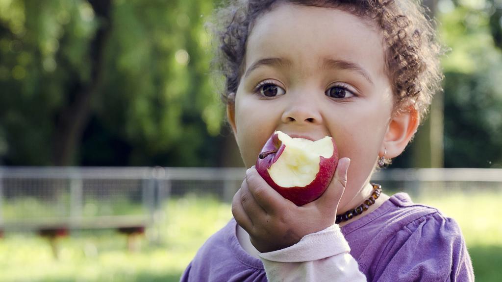 Child eating apple (Credit: Pavla Zakova)