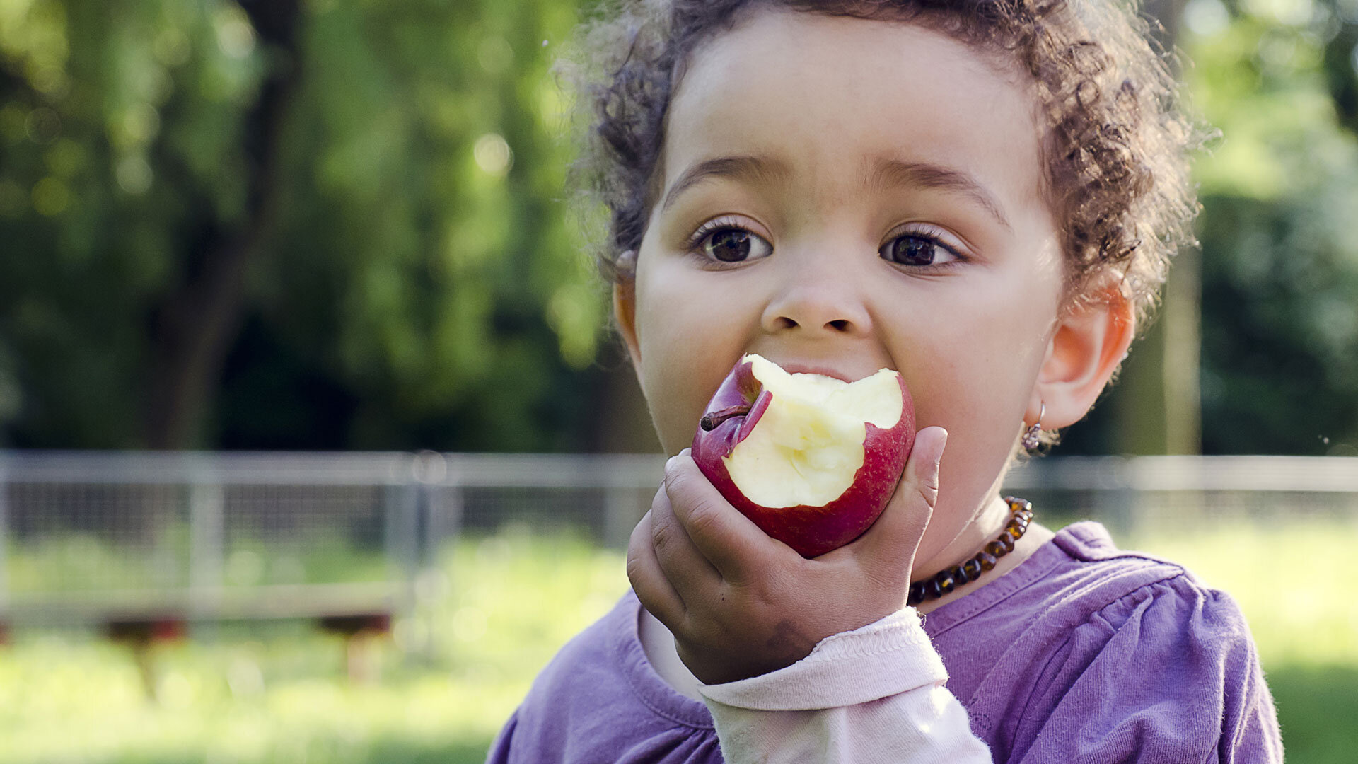 Child eating apple (Credit: Pavla Zakova)